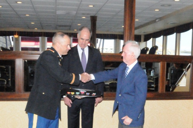 Col. Eric Lawson (left) from the 316th Sustainment Command (Expeditionary) and U.S. Senator Robert P. Casey (center) congratulate, Vietnam veteran, John Ferry (right) of Seven Fields, Pa., after receiving his Bronze Star, Combat Infantryman Badge and seven other awards at a ceremony in Pittsburgh on June 21. After a 42 year wait, Ferry received his awards by requesting assistance from Senator Casey's office. In addition to the Bronze Star and Combat Infantryman Badge; Ferry received the Air Medal, Army Commendation Medal, Good Conduct Medal, National Defense Service Medal, Vietnam Service Medal and Vietnam Campaign Medal.