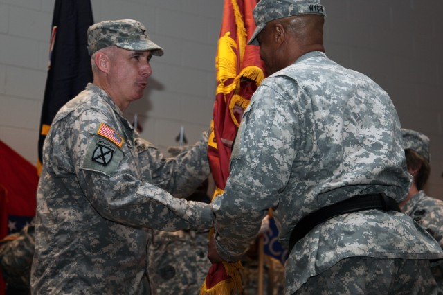Col. John P. Sullivan receives the Transportation Corps colors from Maj. Gen. Larry D. Wyche, Combined Arms Support Command and Fort Lee commanding general to signify his appointment as the commandant of the Transportation School June 21. Sullivan will be responsible for overseeing the training of more than 17,000 students annually.