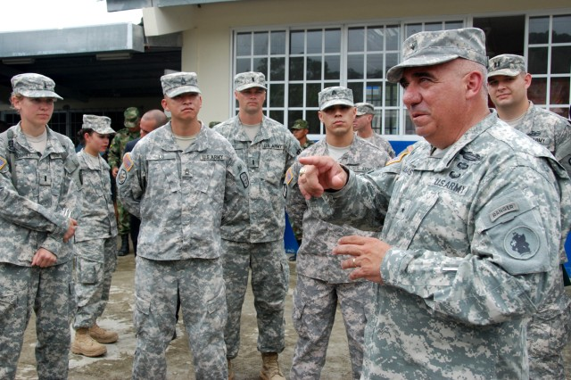 "ACHIOTE, Panama "" Brig. Gen. Orlando Salinas (right), U.S. Army South deputy commanding general, visits with U.S. Army Reserve Soldiers assigned to the 327th Engineer Company based in Onalaska, Wis. after the closing ceremony for Beyond the Horizon-Panama (BTH) 2013. BTH 2013 is an exercise deploying U.S. military engineers and medical professionals to El Salvador and Panama for training, while providing services to rural communities. (U.S. Army photo by Robert R. Ramon, U.S. Army South Public Affairs/Released)"