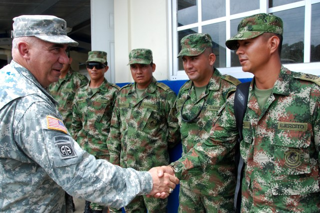 "ACHIOTE, Panama "" Brig. Gen. Orlando Salinas (left), U.S. Army South deputy commanding general, greets Colombian army soldiers after the closing ceremony for Beyond the Horizon-Panama (BTH) 2013. BTH 2013 is an exercise deploying U.S. military engineers and medical professionals to El Salvador and Panama for training, while providing services to rural communities. (U.S. Army photo by Robert R. Ramon, U.S. Army South Public Affairs/Released)"