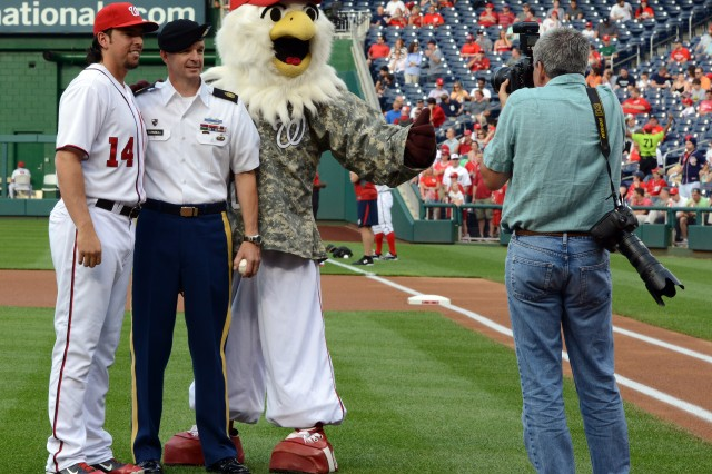 Sgt. Maj. David Turnbull pauses for a photo after throwing out the ceremonial first pitch of the Washington Nationals-Colorado Rockies baseball game, Washington, D.C., June 20, 2013.