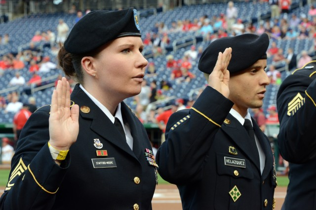 Sgt. 1st Class Jessica Stafford Moore was among the Soldiers who re-enlisted on the field during Army Day at a Washington Nationals home game in Washington D.C., June 20, 2013.
