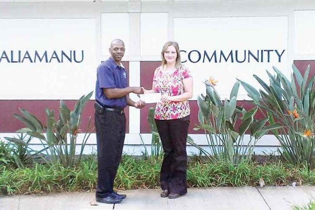 Noelle Savage (right) receives a WinningEdge Scholarship on behalf of WinnCompanies from Leslie Smith of IPC, recently.