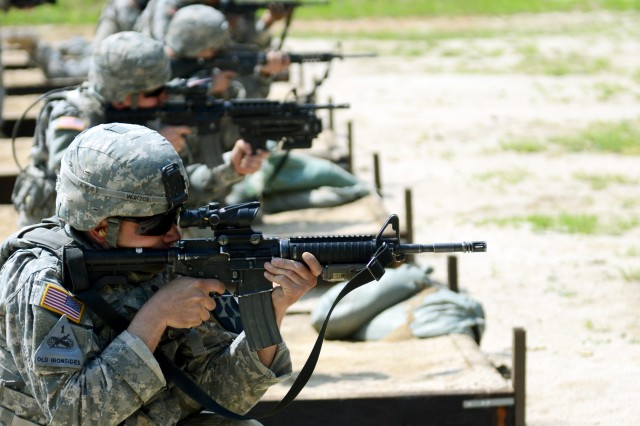 Soldiers participating in the Spartans Shield Ride fire in the kneeling position while qualifying at the M16 range during the competition which ran from May 22 to 23, 2013