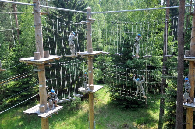 JROTC cadets attempt to maneuver various obstacles of the high ropes course on the Grafenwoehr Training Area, June 21.