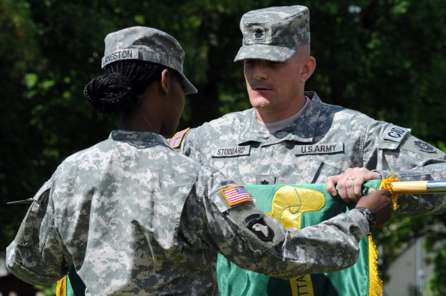 Lt. Col. Jason M. Stoddard, right, the 1002nd Military Police Battalion (Criminal Investigations Division) commander, and Sgt. 1st Class LaTonya Langston, left, the 1002nd MP Bn. first sergeant, case the 1002nd MP Bn. colors during an inactivation ceremony held on the Noncommissioned Officer Field at Daenner Kaserne June 21.