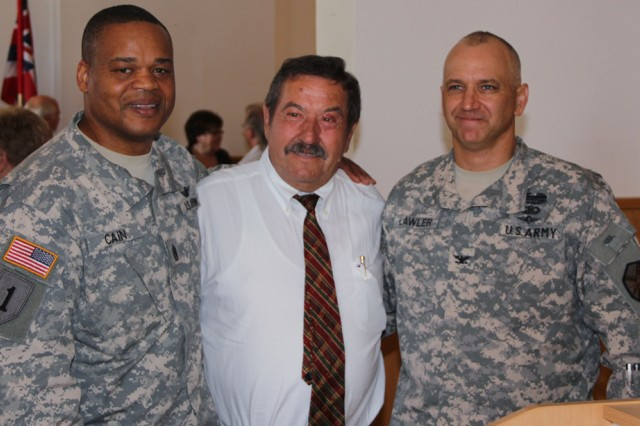 """Rudolf """"Rudi"""" Leykauf poses for a photo with Col. Kelly J. Lawler, U.S. Army Garrison Ansbach commander, and Command Sgt. Maj. Leeford C. Cain, USAG Ansbach command sergeant major, moments before his retirement ceremony June 21."""