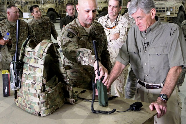 Army Capt. Paul Cluverius, Office of the assistant secretary of the Army for Acquisition, Logistics and Technology, demonstrates the capabilities of a handheld radio at Bagram Airfield, June 21. (Photo by Sgt. Mark VanGerpen, 129th Mobile Public Affairs Detachment)