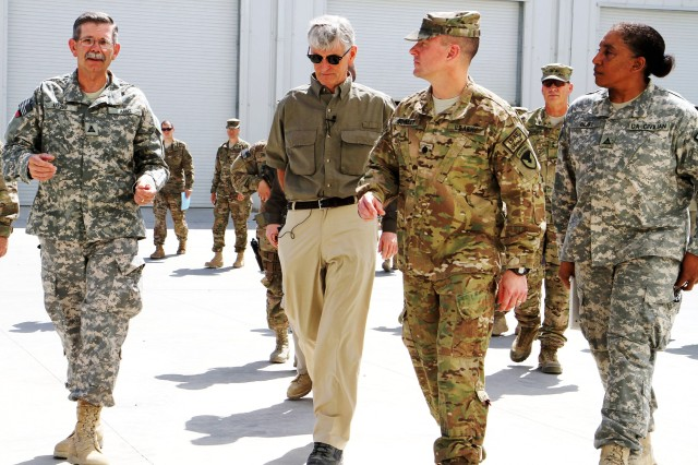 Hon. John McHugh (center), walks with leadership from 401st Army Field Support Brigade, June 21. (Photo by Sgt. Mark VanGerpen, 129th Mobile Public Affairs Detachment)