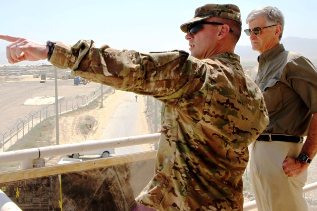 Army Lt. Col. Todd Burnley, battalion commander, 401st Army Field Support Battalion-Bagram, describes retrograde operations to Hon. John McHugh, Secretary of the Army, at Bagram Airfield, June 21. (Photo by Sgt. Mark VanGerpen, 129th Mobile Public Affairs Detachment)