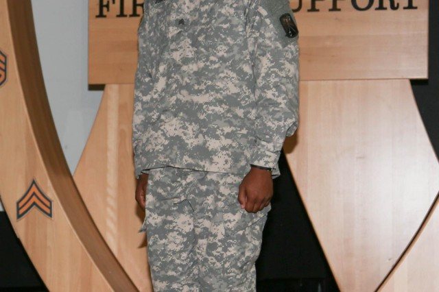 Sgt. Garion Johnson, a signal support systems specialist with the 21st Theater Sustainment Command's 16th Sustainment Brigade, and a native of Detroit, stands in front of the noncommissioned officer gateway prior to being inducted into the noncommissioned officer corps during a ceremony at the Vogelweh Military Complex, June 20. The induction ceremony recognizes recent soldiers that advanced from junior enlisted to noncommissioned officer. (Photo courtesy of the U.S. Army)