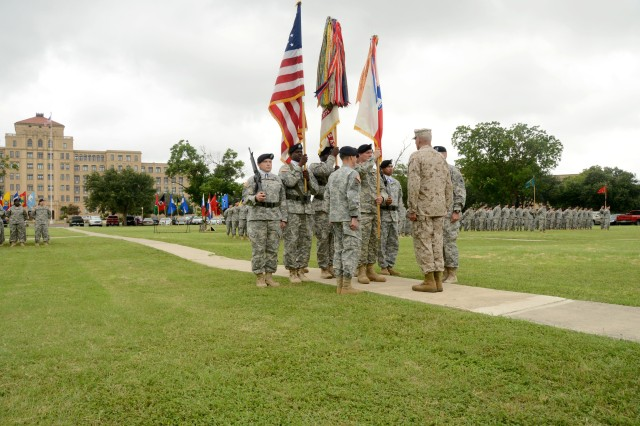 Command Sgt. Maj. Dennis C. Zavodsky (center), the U.S. Army South command sergeant major, stands before Marine Corps Gen. John F. Kelly, the U.S. Southern Command commander, before the transfer of colors between Maj. Gen. Frederick S. Rudesheim, the outgoing Army South commanding general, and Maj. Gen. Joseph P. DiSalvo, the incoming Army South commanding general, during a change-of-commandceremony in front of the Army South headquarters June 24.