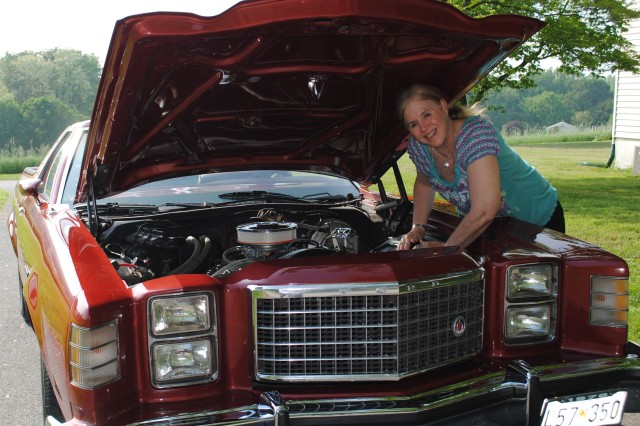 """Ann Hendrix, an administrative assistant with the Army Contracting Command """" Aberdeen Proving Ground, displays her award-winning 1978 Ford Ranchero GT.  She fully restored the red car-truck combination as a classic show car."""