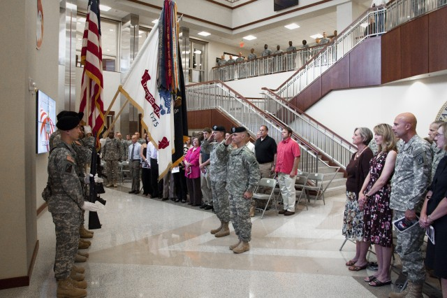 Command Sgt. Maj. Christopher K. Greca (right) and Gen. Daniel B. Allyn, the command sergeant major and commanding general, respectively, for U.S. Army Forces Command, stand at present arms during the National Anthem at Greca's assumption-of-responsibility ceremony June 24, 2013 at Marshall Hall on Fort Bragg, N.C. Greca, who last served as the U.S. Army Combined Arms Center Command Sergeant Major, emphasized training, leadership and experience during his remarks. (U.S. Army photo by Dave Chace, FORSCOM Public Affairs)