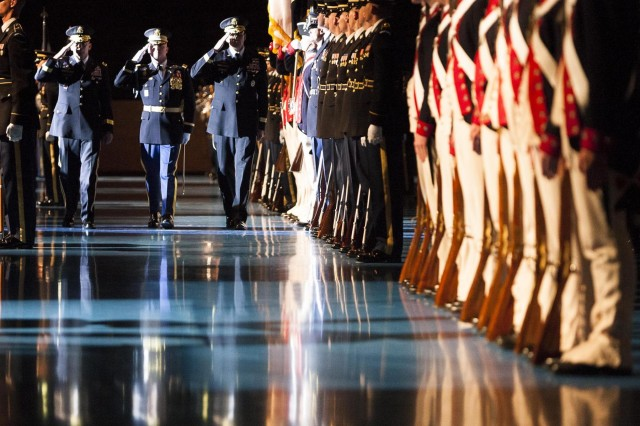 The 3rd U.S. Infantry Regiment (The Old Guard) Commander Col. James C. Markert (center) escorts incoming Commander of Joint Force Headquarters-National Capital Region and U.S. Army Military District of Washington Maj. Gen. Jeffrey S. Buchanan (left) and outgoing JFHQ-NCR/MDW Commander Maj. Gen. Michael S. Linnington (right) to review members of the 3d U.S. Infantry Regiment (The Old Guard) during a change of command ceremony in Joint Base Myer-Henderson Hall's Conmy Hall June 24, 2013.