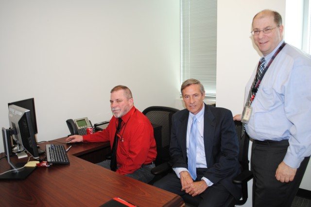 (Left to right) Robert Perry, Army Contracting Command - Aberdeen Proving Ground procurement analyst, spent much of his time with ManTech International Corp. employees Bob Hill and Jon Sirkis.