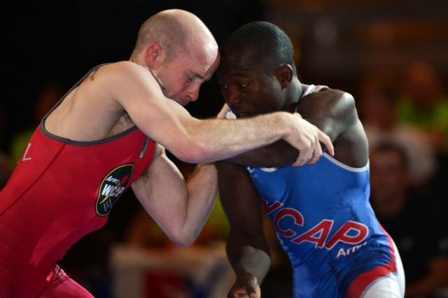 In a battle of U.S. Army World Class Athlete Program wrestlers for a spot on Team USA for the 2013 FILA Wrestling World Championships, Sept. 16-22, 2013, in Budapest, Hungary, Sgt. Spenser Mango (right) defeats Sgt. Nate Engel in the finals of the Greco-Roman 55-kilogram/121-pound division of the 2013 U.S. World Team Trials, June 21, 2013, in Stillwater, Okla. Mango, 26, a native of St. Louis who is stationed at Fort Carson, Colo., is a two-time Olympian. He will be making his fourth appearance in the World Championships.