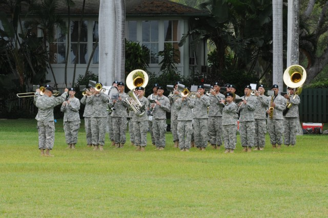 "The 111th Hawaii National Band played during the Flying V Ceremony held in honor of U.S. Army Pacific, Deputy Commanding General, Army National Guard, Maj. Gen. Gary M. Hara. Soldiers from USARPAC performed a ""Flying V"" ceremony in honor of The ceremony was held June 25 at historic at Palm Circle on Fort Shafter. The ceremony was officiated by USARPAC Deputy Commanding General, Maj. Gen. Roger F. Mathews. The Flying V Ceremony traditionally welcomes or honors senior Army officials when they assume duties, depart or retire from an Army Command. The term ""Flying V"" refers to the way the colors are posted during the ceremony, which is V shaped."