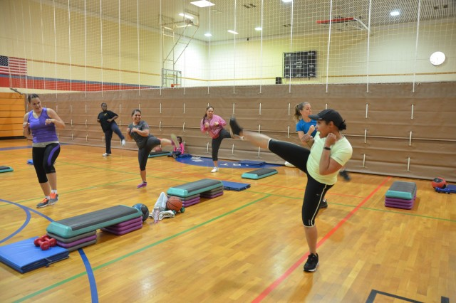 Sgt. 1st Class Patricia Ortiz-Lawas teaches her evening kickboxing class. Combining aerobics, kickboxing and muscle building, her volunteer efforts bring fun and energetic exercise to the Schweinfurt community.