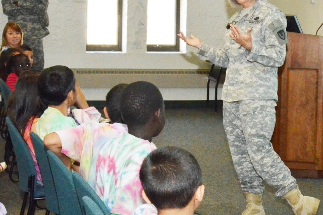 Col. Robin Moralez, operations officer, Army Sustainment Command, gives advice to children from the Casa Guanajuato Quad Cities Fiesta Camp at Rock Island Arsenal, Ill., June 19. (Photo by Elizabeth Adolphi, ASC Public Affairs)