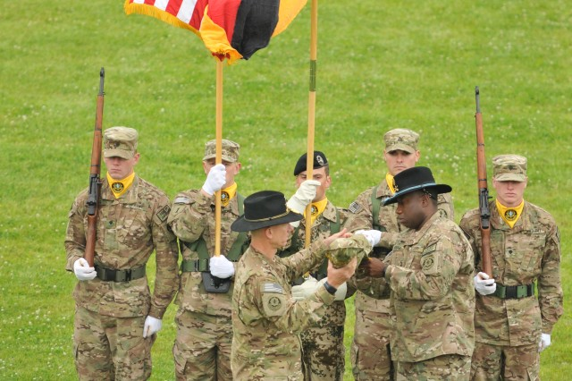 U.S. Army Col. D. A. Sims (front left), commander of 2d Cavalry Regiment, and Command Sgt. Maj. Wilbert E. Engram Jr. (front right), senior enlisted advisor for the Regiment, case the Regimental colors during a color casing ceremony June 26, 2013 at Rose Barracks, Germany. The ceremony represented the Regiments upcoming departure to Afghanistan in support of Operation Enduring Freedom.
