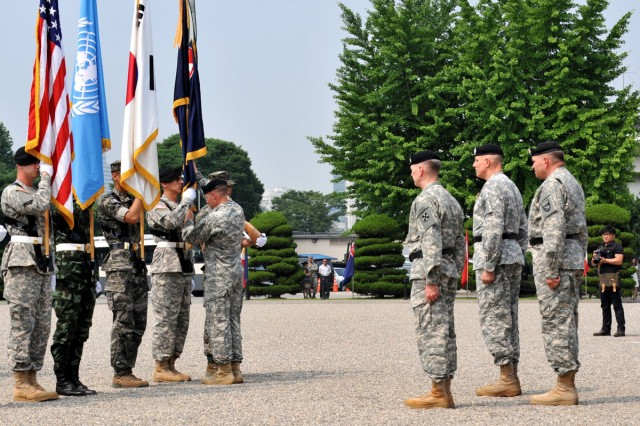 Lt. Gen. John D. Johnson turned over command of Eighth Army to Lt. Gen. Bernard S. Champoux during a ceremony on Yongsan Garrison, South Korea, June 27, 2013.