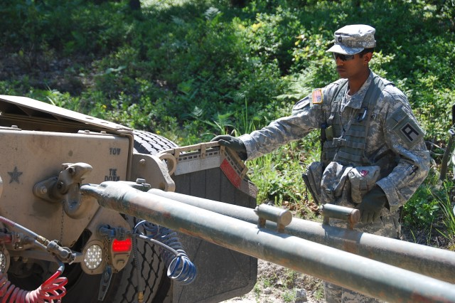 Sgt. 1st Class Panki Miah, 174th Infantry Brigade Trainer/Mentor, helps guide a tow bar into place during a recovery mission, part of the 78th Training Division conducting its Combat Support Training Exercise at Joint Base McGuire-Dix-Lakehurst, N.J.,  June 8-28. Upwards of 40 Trainer/Mentors from the 174th Infantry Brigade served as embedded Observer/Coaches augmenting the three-week training exercise. (U.S. Army Photo by Capt. Antonia Greene-Edwards, 174th Infantry Brigade Public Affairs)