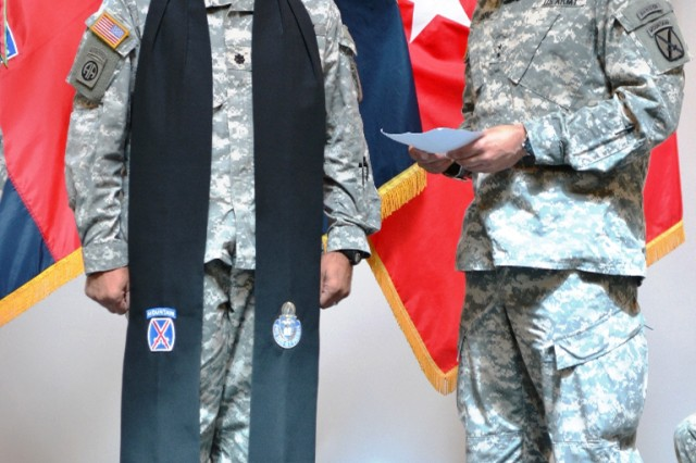 Maj. Gen. Stephen Townsend, Fort Drum and 10th Mountain Division (LI) commander, reads the chaplain's charge to Chaplain (Lt. Col.) Tony S. Petros, incoming division chaplain, during a changing of the stole ceremony June 18 at Riva Ridge Chapel.