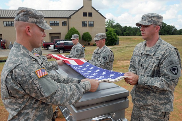 Flight school students practice folding the American flag during a funeral rehearsal at B Company, 1st Battalion, 145th Aviation Regiment. Some flight school students temporarily work at Fort Rucker's Honors Detachment while waiting for various classes in their training to begin.