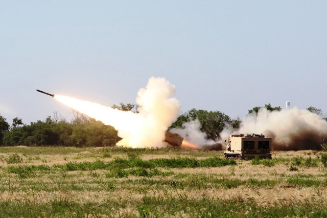 FORT SILL, Okla. -- Fired by Soldiers from 2nd Battalion, 4th Field Artillery, a Multiple Launch Rocket System projectile blazes off toward its target during a 214th Fires Brigade training exercise June 10-14, 2013 at Fort Sill, Okla. The 2-4th FA Soldiers showed the brigade what they can bring to fight when called upon.