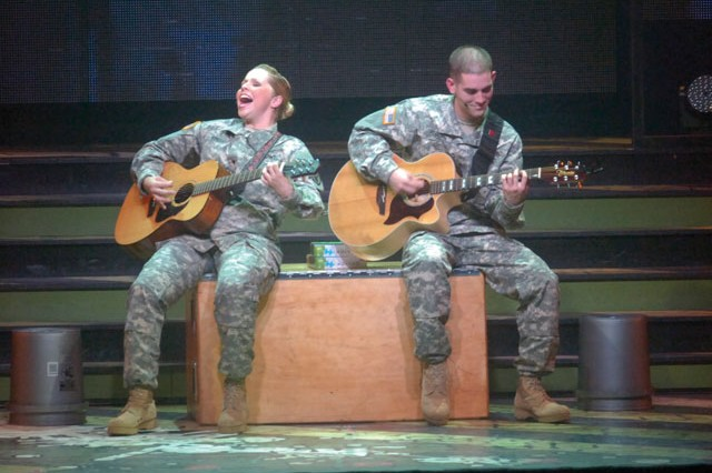 """Spc. Kelly Gregg, left, and Sgt. Alexander Rebling, belt out an acoustic rendition of Aerosmith's """"Dream On"""" during Army Entertainment's Soldier's Show, Friday at Wallace Theatre, Fort Belvoir."""