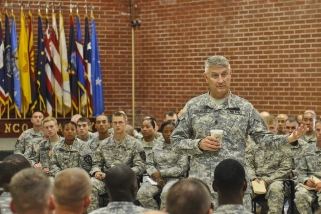 Sgt. Maj. of the Army Raymond Chandler addresses a crowd of Warrior Leader Course students during a visit to the Henry H. Lind Non-commissioned Officer Academy at Joint Base Lewis-McChord, Wash., June 25, 2013. Chandler visited the NCO Academy during a two-day visit to speak about the new gender-neutral Military Occupational Specialty standards that will be implemented in the Army over the next few years.