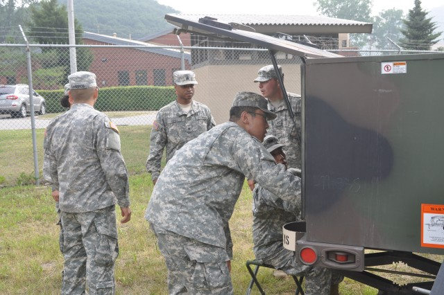 """CAMP CASEY, South Korea """" Soldiers from 210th Fires Brigade conduct signal training on Camp Casey, South Korea June 27, 2013. Soldiers upgrade a modem, set up and test the equipment, and determine whether they are ready to go. This training shows signal Soldiers' readiness to support our force to """"Fight Tonight."""" (U.S. Army photo by Cpl. Kim Han-byeol, 210th Fires Brigade public affairs specialist/Released)."""