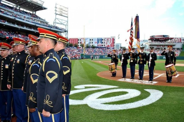 Members of The U.S. Army Band and the 3d U.S. Infantry Regiment's (The Old Guard) Drill Team perform before the crowd at Nationals Stadium for Army Appreciation Day.