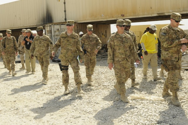 Multiple joint senior logisticians walked through the Defense Logistics Agency disposition services yard, at Bagram Airfield, Afghanistan, June 27, 2013, to review operations and identify ways to accelerate support of disposition and drawdown of equipment.