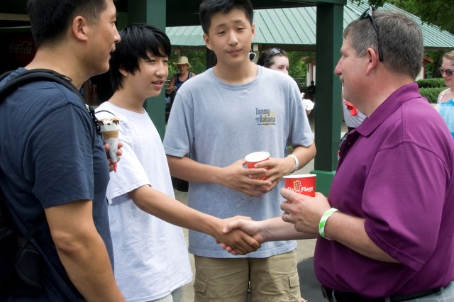 Jun Zhang, a physicist with the U.S. Army Research Laboratory, introduces his son Dean (middle) and Tom (right) to the new ARL Director Dr. Thomas Russell, during the Adelphi Laboratory Center Organization Day at Six Flags America June 27.  More than 850 attended this year's event, sponsored in part by the ALC Morale Welfare and Recreation Council.