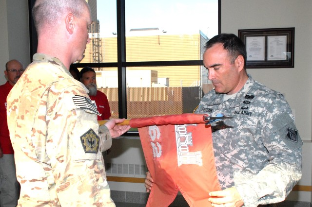 Col. Christopher Lestochi, district commander, uncases the colors of the 62nd Engineering Detachment with Capt. Corey Warren, detachment commander, during a ceremony June 26 at the district headquarters building. The team was deployed September 2012 through June 2013 in support of Operation Enduring Freedom at Shindand Air Base, Afghanistan.