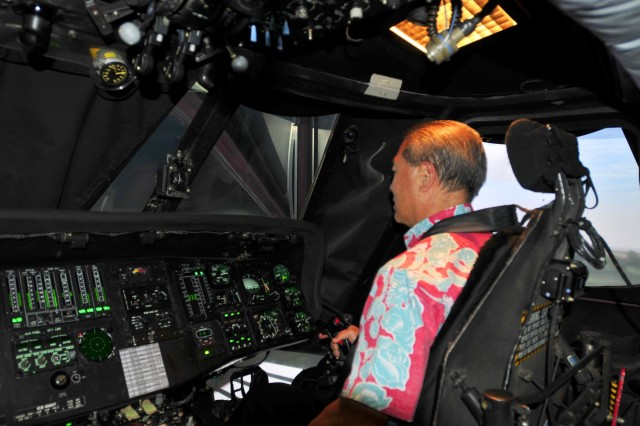 Gerard Akaka, the vice president of Medical Affairs with the Queen's Medical Center, scans the area ahead of him as he flies in the UH-60 Black Hawk simulator during a visit to the 25th Combat Aviation Brigade, 25th Infantry Division, to learn about the Army's risk management process for its pilots on Wheeler Army Airfield, Hawaii, June 12.