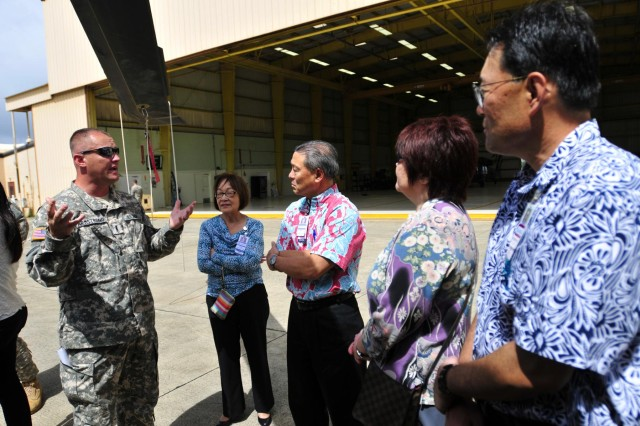 Chief Warrant Officer 3 Roger Armstrong, a pilot assigned to Company C, 3rd Battalion, 25th Aviation Regiment, 25th Combat Aviation Brigade, briefs medical officials from Queens Medical Center about the Army's risk management process for its pilots during a visit to the 25th CAB, 25th Infantry Division on Wheeler Army Airfield, Hawaii, June 12.