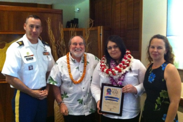 Katelyn Brown (right center), a native of Robbins, N.C., and step-daughter of Staff Sgt. Brian Walter (left), Headquarters and Headquarters Company, 2nd Battalion, 25th Aviation Regiment, 25th Combat Aviation Brigade, and Steffanie Walter (right), was awarded with the 2013 Boys and Girls Clubs of America Hawaii Military Youth of the Year Award by the Governor of the State of Hawaii, Neil Abercrombie, at the Hawaii State Capitol March 19.