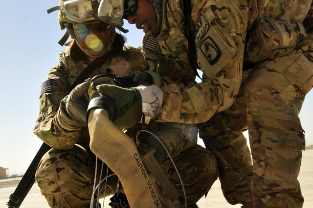Soldiers from 3rd Battalion, 158th Aviation Regiment, Task Force Storm, currently attached to the 25th Combat Aviation Brigade, use teamwork to hook up a nozzle to a fuel hose during an exercise to set up a Jump Forward Arming and Refueling Point on Forward Operating Base Shindand, Afghanistan, Oct. 3.