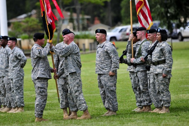 U.S. Army Col. Frank Tate, outgoing commander of the 25th Combat Aviation Brigade, transfers his command to Col. Kenneth Hawley, during a change of command ceremony at Schofield Barracks, Hawaii, April 30, 2013.  (U.S. Army photo by Capt. Richard Barker/Released)