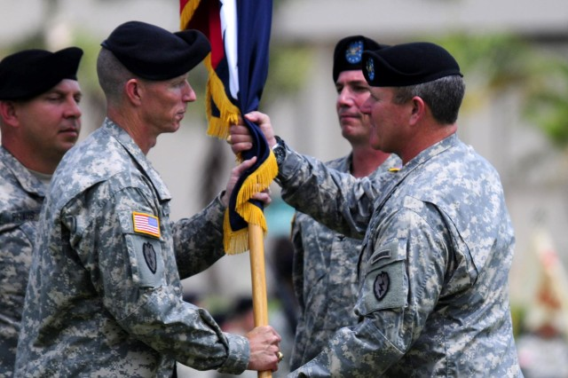 Col. Frank Tate, outgoing commander the 25th Combat Aviation Brigade, transferred his command and responsibility of the combat aviation brigade to Col. Kenneth Hawley, incoming 25th CAB commander, during the 25th CAB change of command ceremony on Schofield Barracks, Hawaii, April 30.