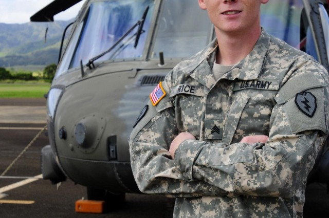 Sgt. Zachary Rice, Company C, 2nd Battalion, 25th Aviation Regiment, 25th Combat Aviation Brigade, was selected as the 2012 Army Aviation Association of America's Henry Q. Dunn Crew Chief of the Year. Sgt. Rice was presented with the award by Command Sgt. Maj. James Thomson, CSM of the Army Aviation Center of Excellence, on Wheeler Army Airfield, Hawaii, March 25. (Photo by Sgt. Daniel Schroeder, 25th Combat Aviation Brigade Public Affairs)