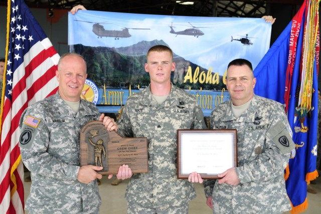 Sgt. Zachary Rice (center) was selected as the 2012 Army Aviation Association of America's Henry Q. Dunn 2012 Crew Chief of the Year.  Sgt. Rice was presented with the award by Command Sgt. Maj. James Thomson (right), CSM of the Army Aviation Center of Excellence, on Wheeler Army Airfield, Hawaii, March 25.  Maj. Gen. Kevin Mangum (left), commander of the Army Aviation Center of Excellence, also attended the award ceremony to congratulate Rice on his achievement. (Photo by Sgt. Daniel Schroeder, 25th Combat Aviation Brigade Public Affairs)