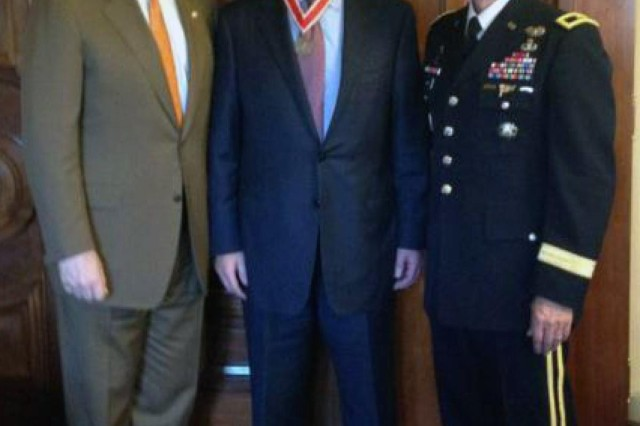 Ray Russo, center, acting director of Regional Business for the Southwestern Division, U.S. Army Corps of Engineers, was recently presented with a bronze de Fleury Medal by Sen. John Cornyn, R-Texas, left, and Brig. Gen. Thomas W. Kula, Southwestern Division commander.