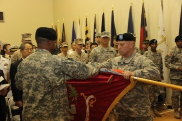 Lt. Col. Kevin D. McCarley, commander,83rd Ordnance Battalion Command Sgt. Maj. Lenard D. Pitts, CSM 83rd Ordnance Battalion case their colors during an Inactivation Ceremony at the Kure Ammunition Depot on June 26th.