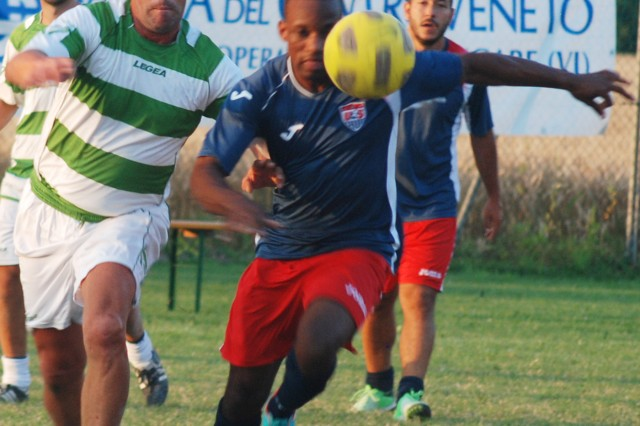 Vicenza Lions' Corey Ashley, right, goes for the ball in midfield during the final game against the Alpini Basso Vicentino team while Arric Alicea (back) looks on. The Vicenza Lions placed second in the soccer tournament held in Settecà June 22.