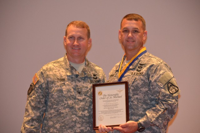 Lt. Col. Heyward Wright (right) is recognized with the Order of Saint Michael, Bronze Award by Col. Thomas Todd, vice president for the Army Aviation Association of America Tennesee Valley Chapter and Utility Helicopters Project Manager, during a ceremony June 26.