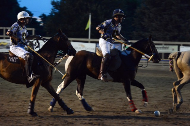 Veterans play in a friendly Army-Navy polo match in The Plains, Va., June 29, 2013. The Great Meadow Polo Club hosted a Military Appreciation Night to honor the service and sacrifice of the men and women who have served.